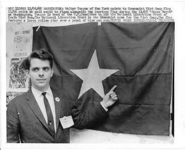 Walter in 1965 in Washington DC with NLF flag.